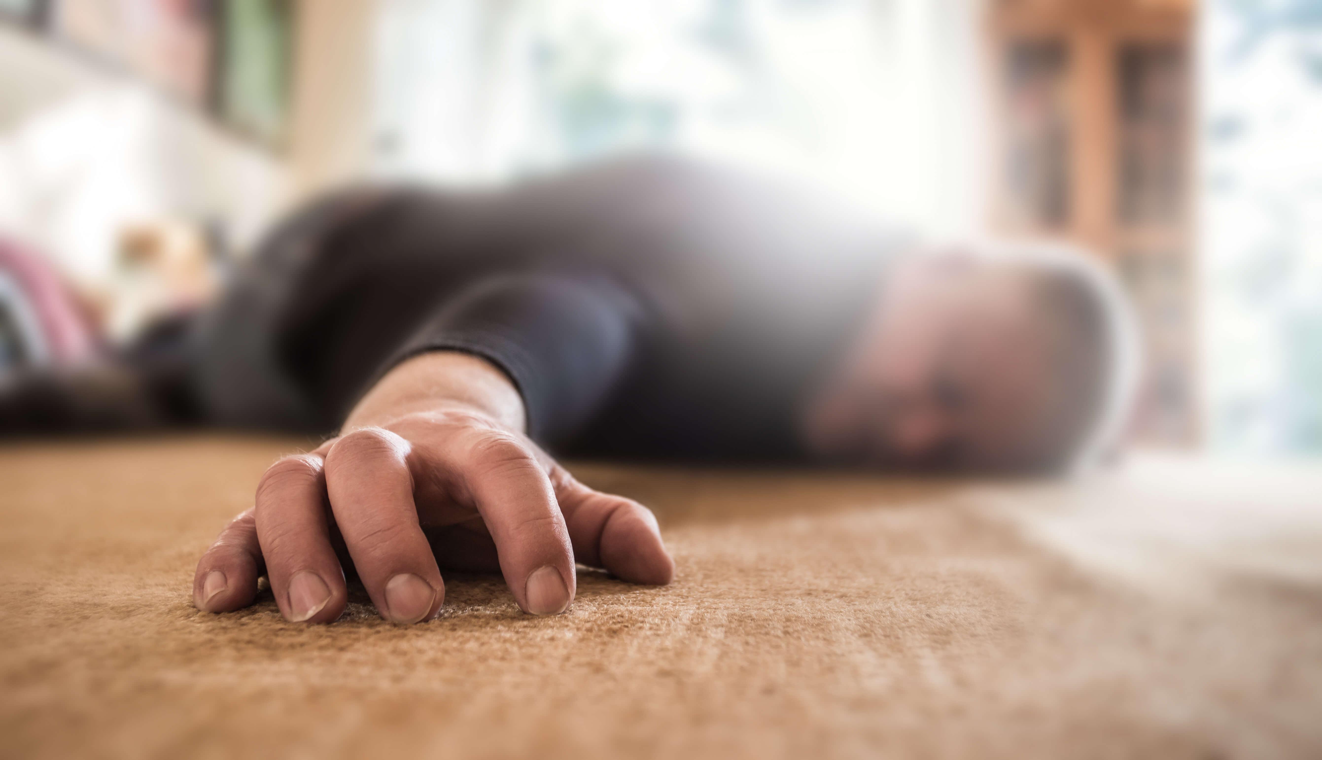 man collapsed on floor
